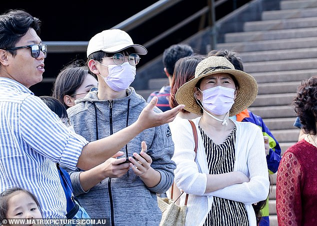Passengers from a China Cruise Ship are seen arriving at Sydney Opera House with no health screen checks amid fears of the coronavirus outbreak on February 27
