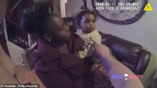 WATCH: White Police Sergeant Sees Black Mother Standing on a Street Corner Holding Balloons then Gives her a Ride Home and Buys a Cakefor her Daughter's First Birthday. See the Adorable Moment the Little Girl Hugs the Police Officer