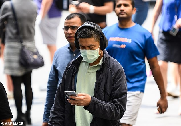 Pictured: A man walking through Sydney with a face mask on amid coronavirus concerns on March 2
