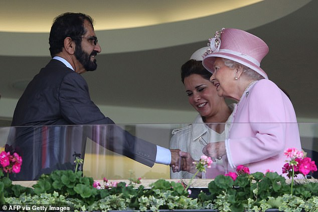 Sheikh Maktoum is pictured shaking hands with the Queen at Ascot racecourse in June 2016 alongside his ex-wife Princess Haya Bint Al-Hussein
