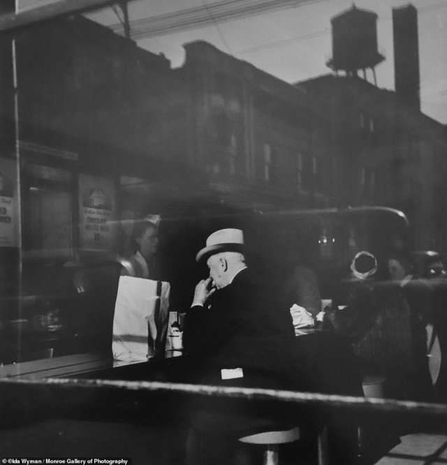 A quick bite at Wimpy's Glorified Hamburger in Chicago, 1946. Wimpys was a popular burger joint that started in the Windy City in 1934, it's name was inspired by 'J. Wellington Wimpy' the hamburger-loving character from the Popeye cartoons.