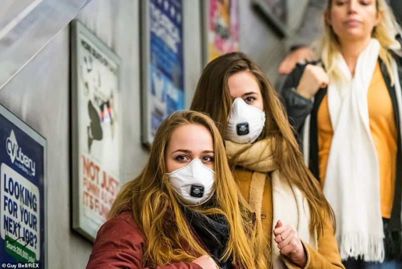 European visitors cautiously travel on the Victoria Line on Friday as coronavirus spreads across the United Kingdom