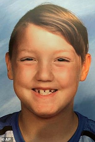 Lori's children, seven-year-old Joshua 'JJ' Vallow (pictured) and 17-year-old Tylee Ryan, were last seen in Idaho in September but were never reported missing by their mother or the man she married weeks later, prolific doomsday author Chad Daybell