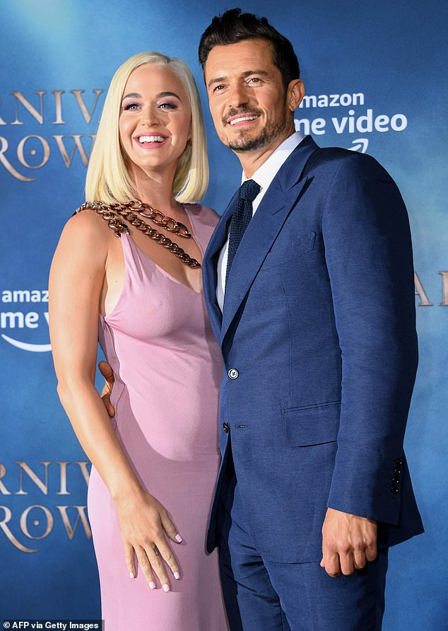 Happy couple: Actor Orlando Bloom, 43, proposed to Katy on Valentine's Day in 2019. They are pictured in August