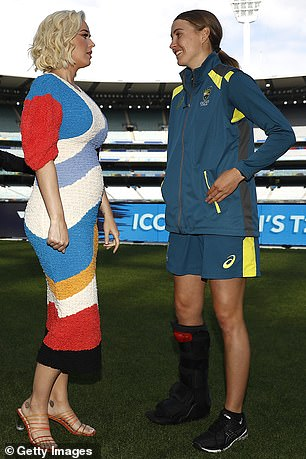 Sports star: Katy is pictured with Australian cricketer Tayla Vlaeminck