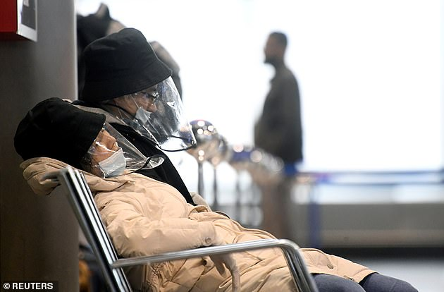 Passengers inMalpensa airport, near Milan, wait for their flight from the quarantined region of northern Italy