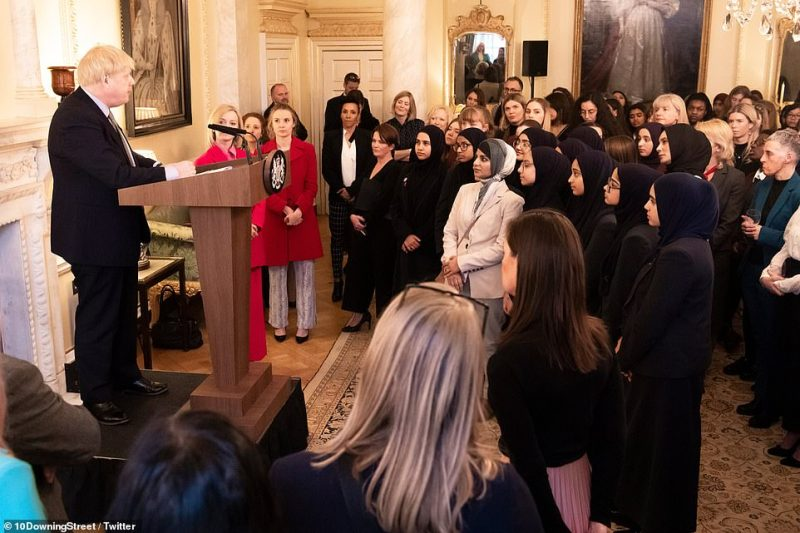 Boris Johnson speaks at an International Women's Day event in No 10 last Thursday, which was attended by Ms Dorries. The PM says he did not go near her that day. The event was attended by his partner Carrie, minister Liz Truss (in red next to the podium) and Olympian Kelly Holmes (pictured in a black suit two places to Ms Truss' left)