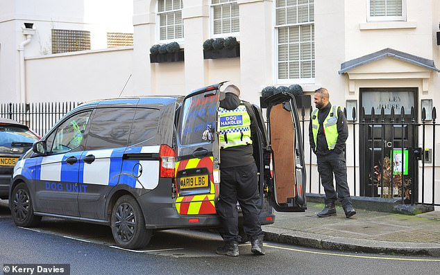 Back-up: Guard dogs during seizure of £11m Belgravia mews villa. He was nowhere to be seen as he lost his four-bedroom home
