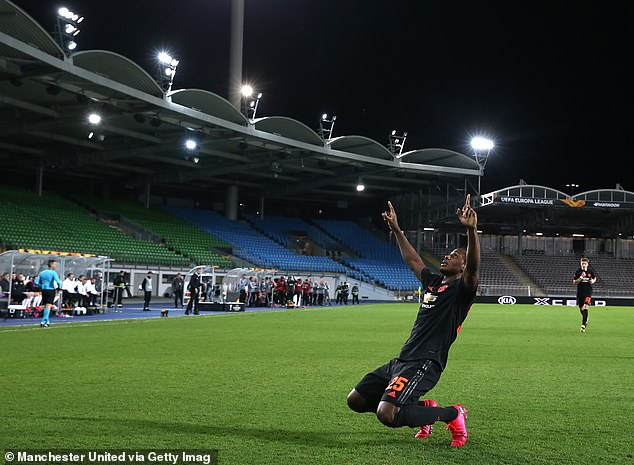 Odion Ighalo celebrates scoring for Manchester United in an empty stadium on Thursday night