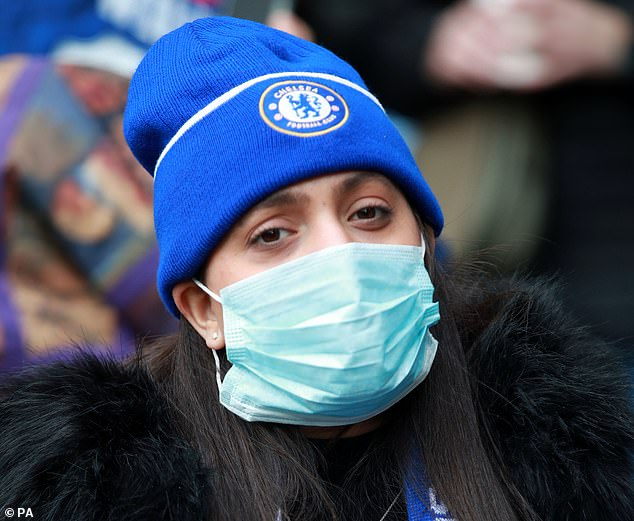 A Chelsea fan is seen wearing a protective mask at last week's match at Stamford Bridge