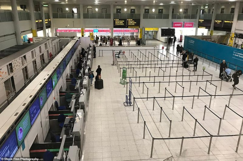 The deserted check-in at Gatwick's south terminal today where fewer and fewer people are flying due to coronavirus and thousands of flights to hotspots have been cancelled up until Easter