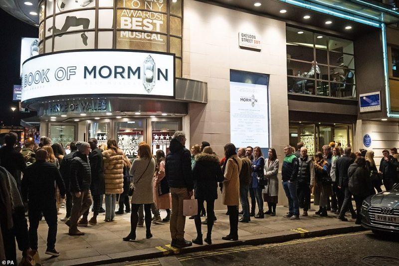 Huge crowds gathered outside theatres this evening for popular West End shows near Leicester Square such as The Book of Mormom (pictured) and Les Miserables