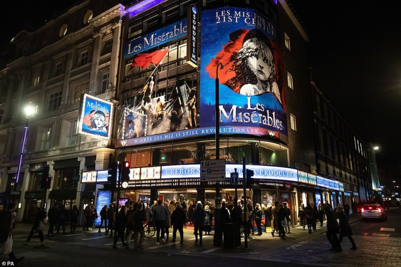 This evening in the capital coronavirus panic did not seem to stop people enjoying a night out at the theatre. Pictured: people queue up to see Les Miserables at theSondheim Theatre near Leicester Square