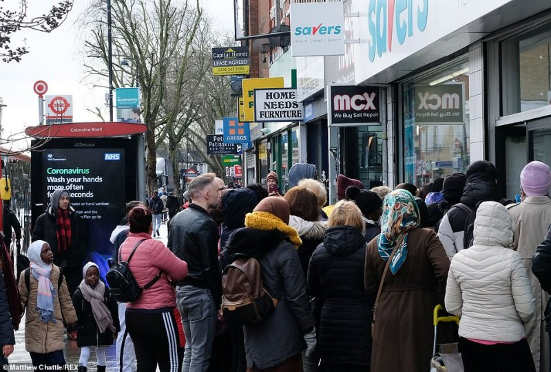 Crowds gathered on paths beside Sainsbury's in Ladbroke Grove and Savers in Wood Green (pictured), both London, as the threat of a lockdown looms
