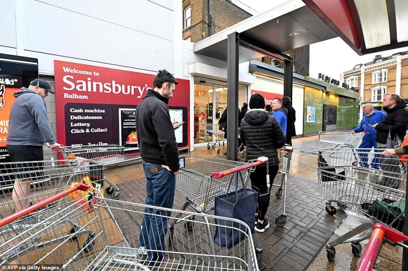 Firms are working closely with the Government and suppliers, and have arranged more store deliveries to ensure shelves are stocked, the letter added. Pictured: A Sainsbury's in London