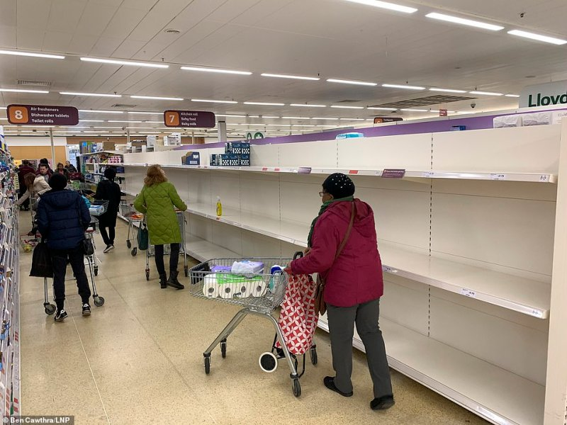 Toilet roll shelves have been completely raided at Sainsbury's in London immediately after it opened at 7am