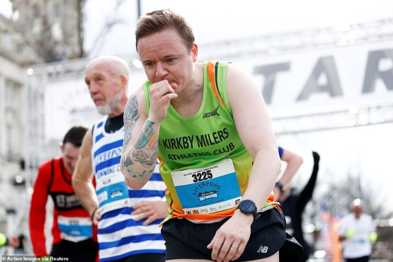 A man completes the Liverpool Half Marathon - after training for months many participants chose to turn up regardless of the risk posed by COVID-19