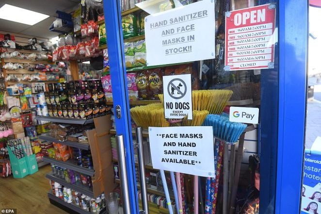 Shops including this one in south London have been stocking up on hand sanitiser and face masks as the UK braces itself for the carnage to accelerate