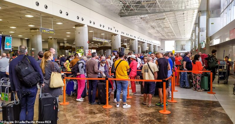 The exodus of Brits from Spain gathered speed today as airports witnessed scenes more typical of summer (South Tenerife Airport pictured yesterday)