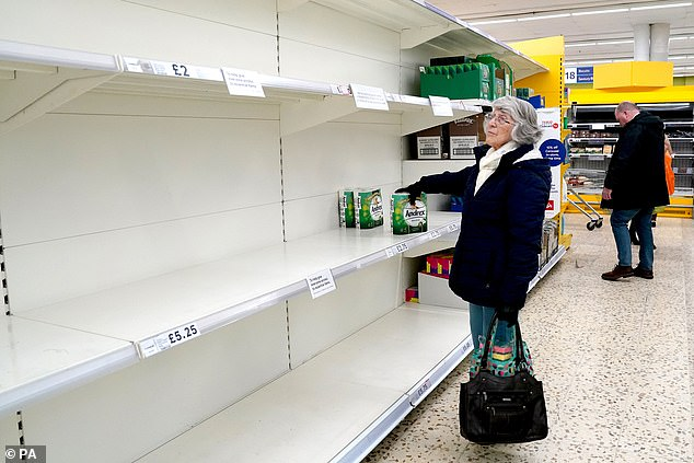 Elderly people - the most at risk from coronavirus - have struggled to get essentials due to panic buyers raiding shelves. A woman buys toilet roll at a Tesco in Chester