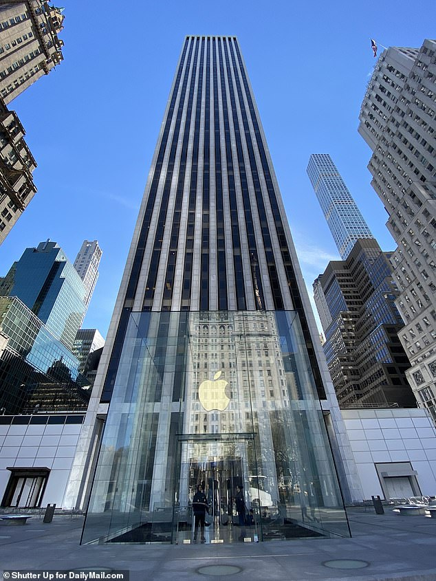 Apple's empty flagship store on 5th Avenue pictured above after the company announced it will shutter for two weeks