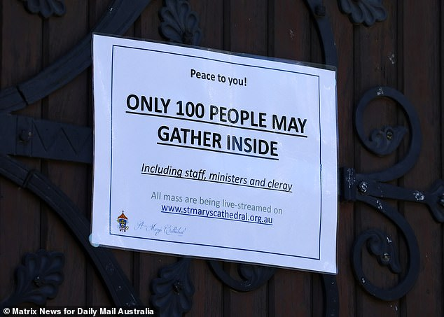 Newly-made signs at St Marys Catherdral warn visitors on Wednesday that only 100 people - including staff, ministers and clergy, can enter (pictured)