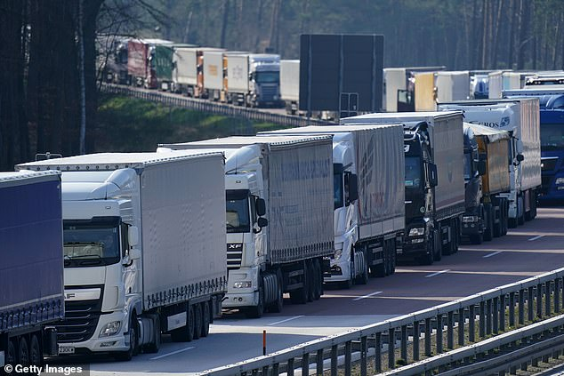 Trucks on the A12 highway stand backed up approximately 70km before Germany's border to Poland on Wednesday