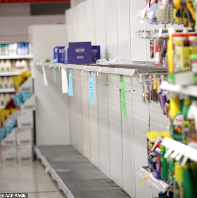 Toilet paper shelves have been ravaged across the country as the product quickly became a hot commodity amid  panic buying hysteria. Pictured is a Coles supermarket  in Adelaide on March 13
