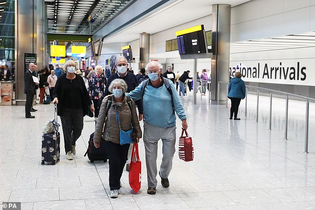 Some of the holidaymakers who had been trapped on the Braemar cruise ship in Cuba are pictured walking home through Heathrow Airport this morning after flying home