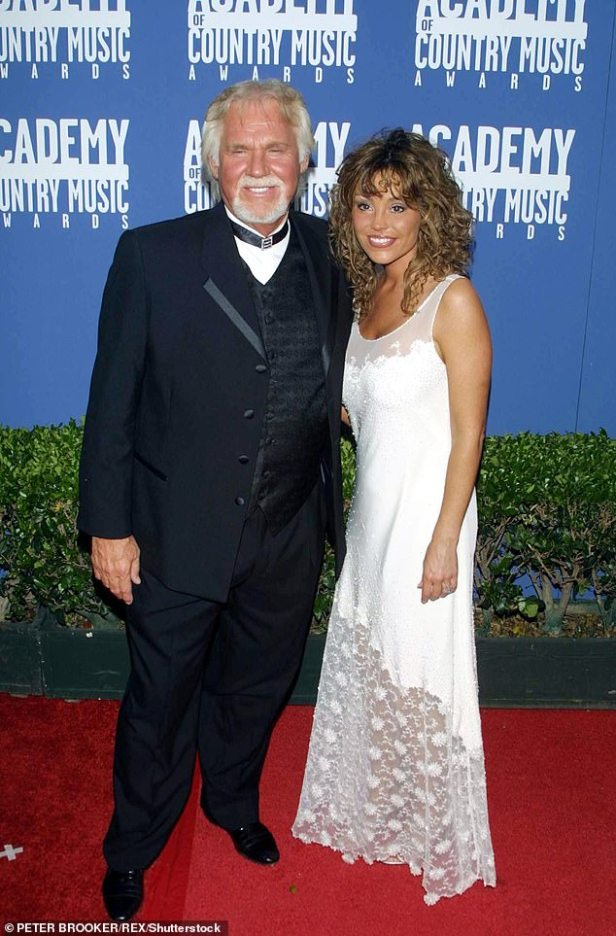 Lots of love: Rogers pictured with wife Wanda Miller at the Country Music Awards in LA in May 2001