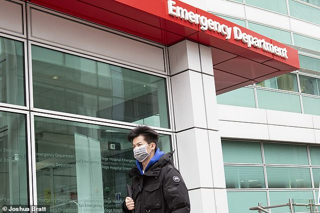 The extra resources, now secured by the health service, will not only be available to treat coronavirus patients, but will also help the NHS deliver other urgent operations and cancer treatments. Pictured: A man wearing a mask walks past University College Hospital's A&E department in London