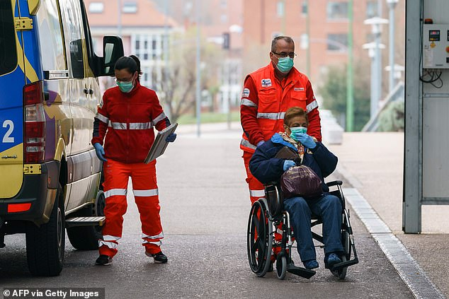Spain is currently the second hardest hit European country after Italy and has so far reported 28,603 confirmed cases and 1,756 deaths. Pictured: Scenes outside Burgos Hospital
