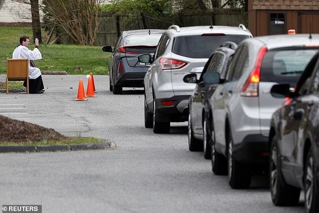 In the U.S. Reverend Scott Holmer was seen offering absolution to people in their cars outside his church in Maryland
