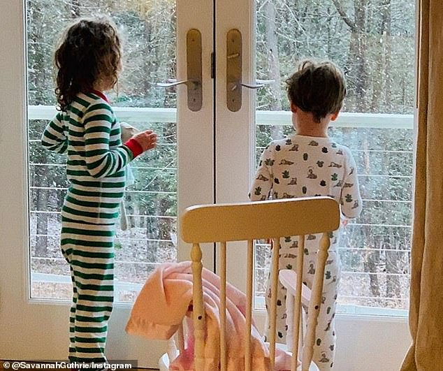 Special moments: She shared this image of her children enjoying the snow on Monday morning, days after revealing she had come down with 'a mild sore throat'