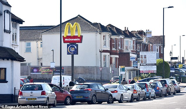 McHurry! Cars queue to get into the McDonald's in Swaythling, Southampton, following the news that the fast food chain closed stores at 7pm