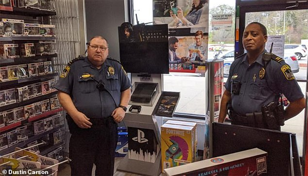 GameStop initially said it would keep all of its stores open because it provided 'essential' goods and services for people transitioning to telecommuting. In Athens, Georgia, police visited a GameStop with an ordinance insisting the store close (pictured above)