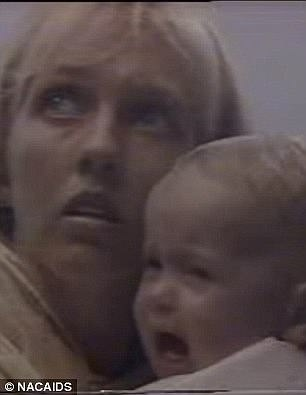A mother cradles a child as they both face imminent death at the Grim Reaper's hands