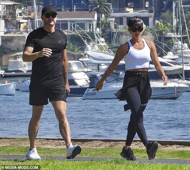 Activewear: She accessorised with sunglasses, black sneakers and a baseball cap