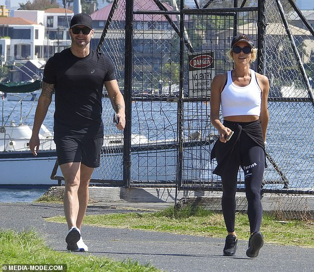 Back in black:He stepped out in a pair of white sneakers and, like Pip, concealed his gaze behind sunglasses and a cap