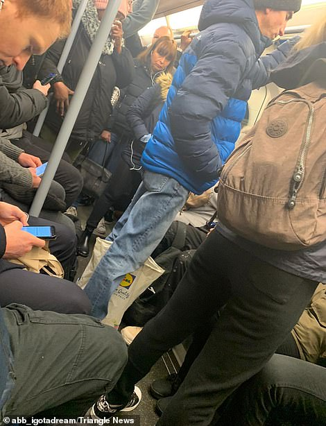 Packed platforms and trains in London were a common scene again today on Britain's first day of a three-week lockdown