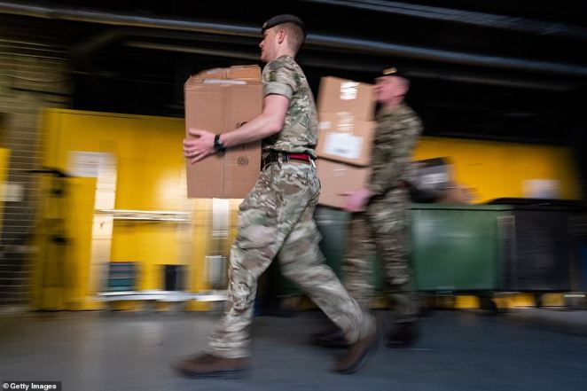The Army is helping deliver protective equipment such as masks, safety glasses and suits round the clock to hospitals today