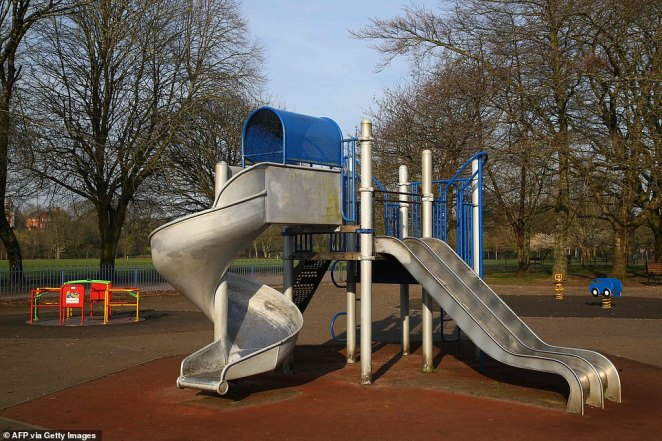 A picture shows an empty children's play area on Llandaff Fields in Cardiff, as community facilities like these were also closed off