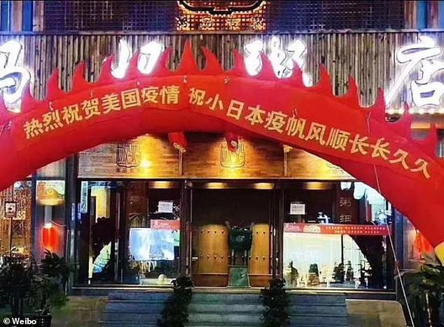 The red banner was placed in front of the restaurant in northern China yesterday and read: 'Huge congratulations to the American epidemic and long live the epidemic in little Japan'