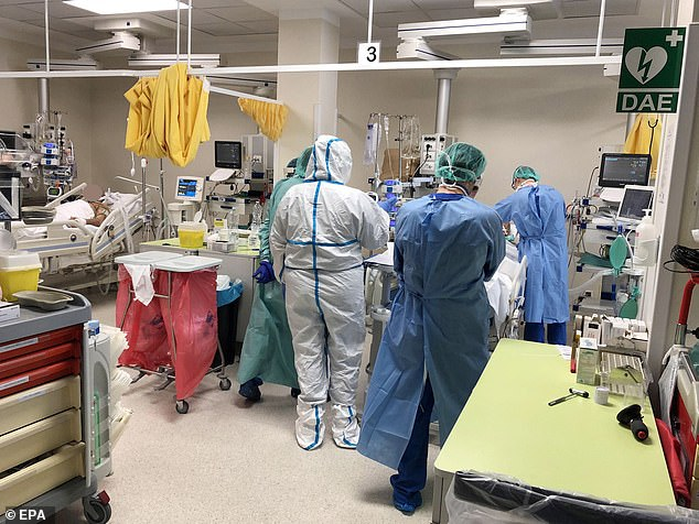 Doctors and nurses wearing protective suits now treat patients with coronavirus in the intensive care unit of the VIzzolo Predabissi hospital in Milan