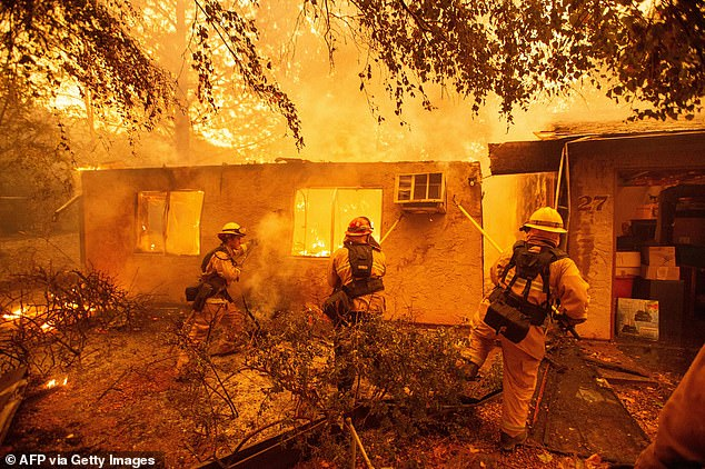 Utility company Pacific Gas & Electric has pleaded guilty to 84 counts of manslaughter in the deadly Camp Fire that razed Northern California in 2018. Firefighters pictured tackling the fire in Paradise, California on November 9, 2018