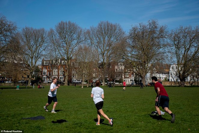 Groups were also  exercising in the spring sunshine in Fulham today - but were not sticking to the maximum of two people together at one time