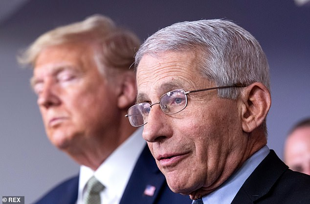 Dr. Tony Fauci called into a local Washington D.C. radio station to dispute talk there is any tension between him and President Donald Trump. Here he's photographed standing alongside President Trump in the briefing room on March 17