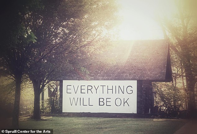 The Georgia city of Dunwoody is showing solidarity by erecting the optimistic signs