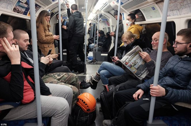 A busy Jubilee line eastbound train carriage, the day after Prime Minister Boris Johnson put the UK in lockdown to help curb the spread of the coronavirus
