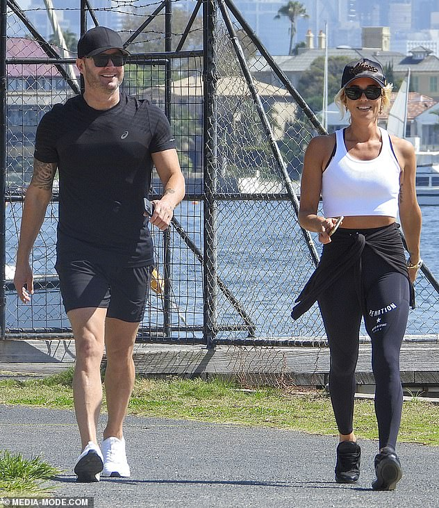 They're not hiding anymore! Michael Clarke and Pip Edwards looked very friendly indeed while taking a morning stroll around Sydney's Rose Bay onSunday